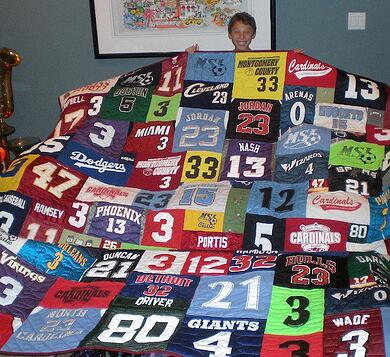 A young boy with a T-shirt quilt full of his player's numbers
