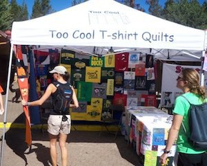 Too Cool T-shirt Quilts set up at a show with our quilts.