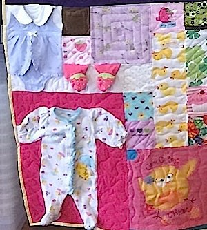 baby clothing used in a T-shirt quilt