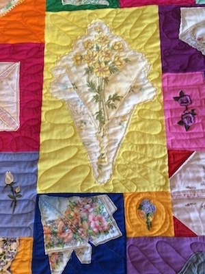 Example of how a hankie was folded and used in a quilt.
