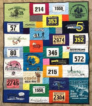 A runners T-shirt quilt that includes both T-shirts and race bibs.
