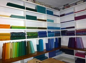 The best fabric for a T-shirt quilt is 100% cotton. This is a room full of the good stuff - fabric.