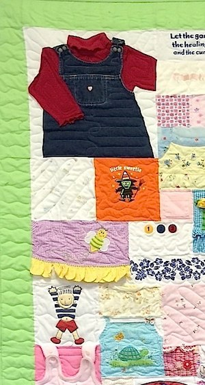 Close up of a baby clothes quilt