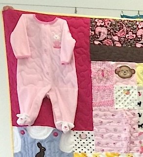 whole baby outfit in a baby clothes quilt.