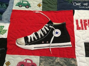 Converse shoe used in a T-shirt quilt. Now that is too cool!