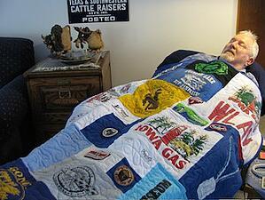 Sleeping under a T-shirt quilt