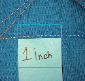 11 stitches per inch is industry standard for T-shirt quilts.