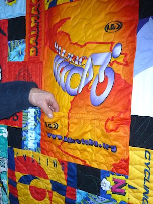 A close up of a bicycle jersey used in a quilt. The pocket is still useable.