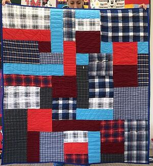 plaid quilt made with plaid shirts and t-shirts