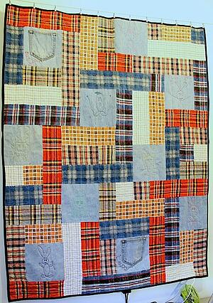 plaid and blue jeans made into a quilt.