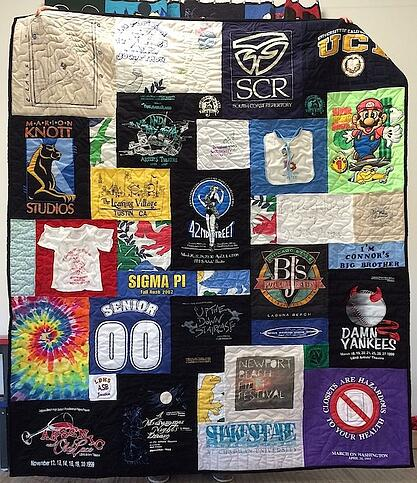 An unwanted block in a T-shirt quilt covered up with a new block.