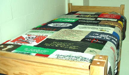 Dorm bed with a T-shirt quilt