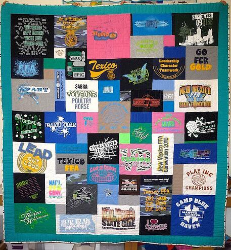 This is a photo of a T-shirt quilt with one block in upside down.