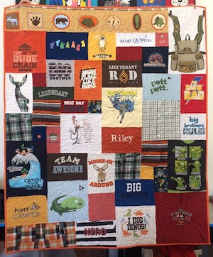 a memorial quilt made from clothing of a little boy