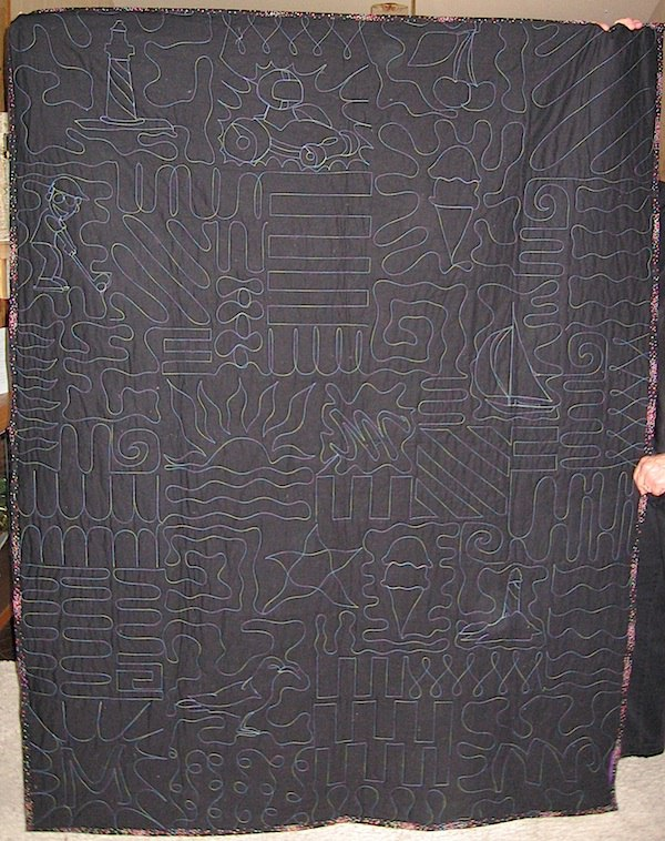 This is the back of a T-shirt quilt. You can see how the blocks were individually quilted.