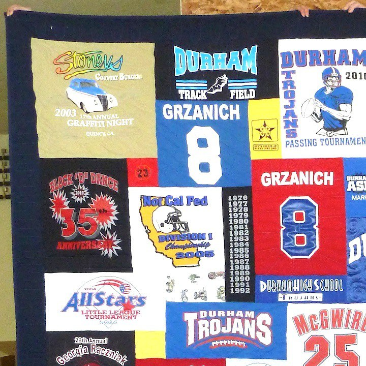 "T-shirt quilt with a 4"" solid border"