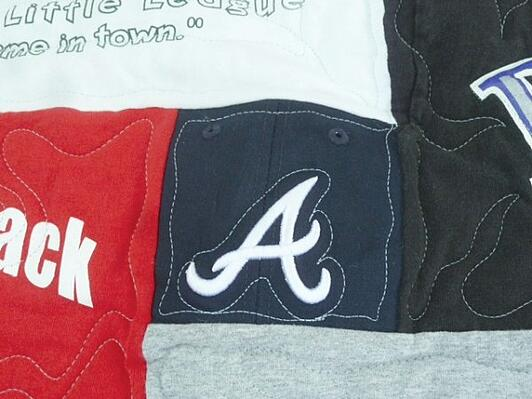 baseball cap used in a T-shirt quilt