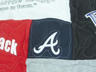 Baseball cap emblem used in a T-shirt quilt