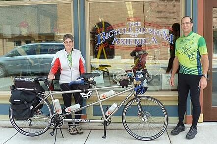 Two bikers with a tandem