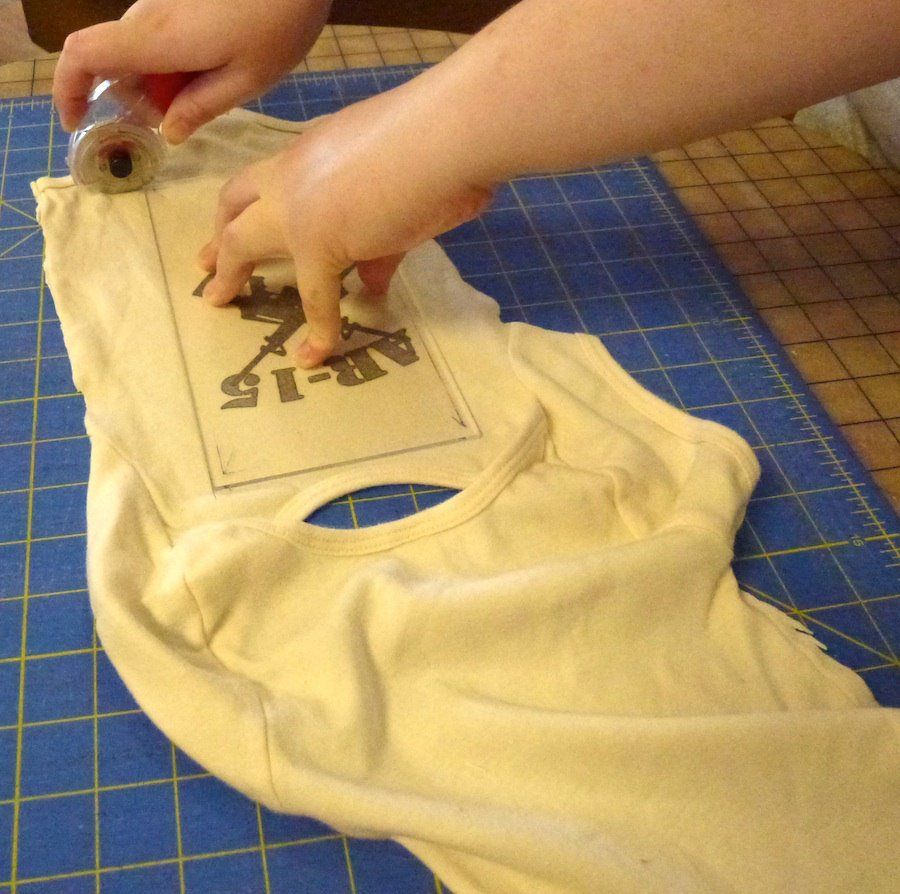 Cutting baby clothes for a quilt
