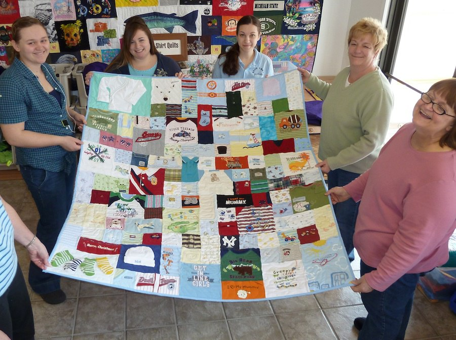 Checking out a baby clothes quilt