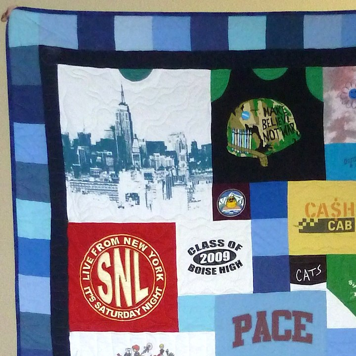 "T-shirt quilt with a 4"" pieced +2"" solid border"