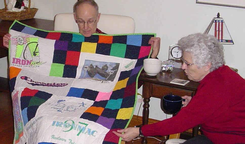 T-shirt quilt being admired by grandparents