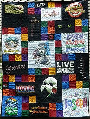 Theater T-shirt quilts was made larger with blank blocks.