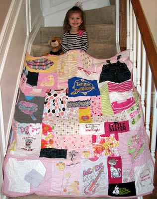 A young girl with her baby clothes quilt
