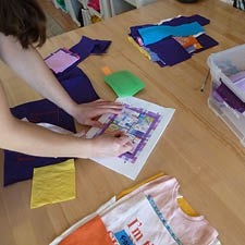Coloring individual blocks onto a layout for a T-shirt quilt.