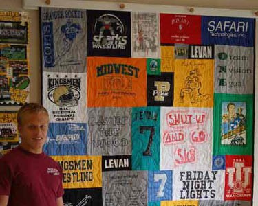Quilt hung using loops on a rack