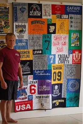 Boy next to hanging Graduation T-shirt Quilt