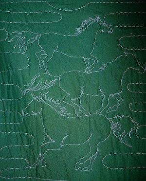tracings on the back of a T-shirt quilt