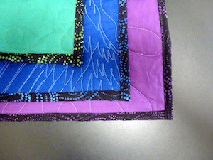 Examples of backing and binding on T-shirt quilts