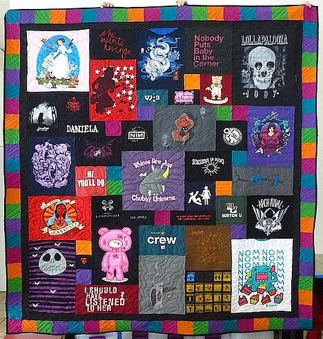 A T-shirt quilt with a Jewel Tone pieced border