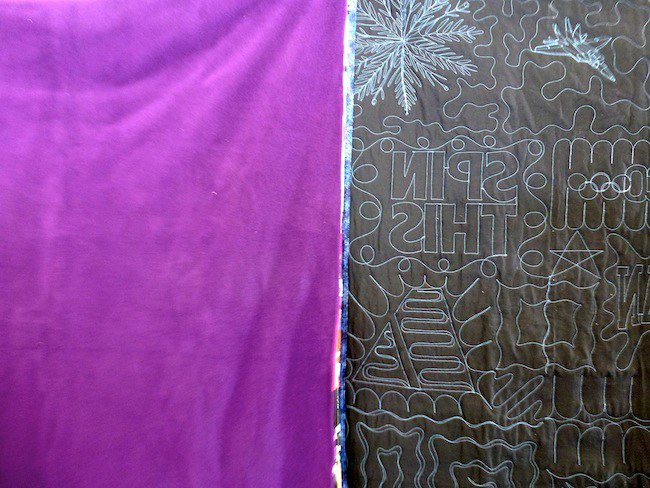 Compare the backs of a traditional style T-shirt blanket to a puzzle style T-shirt Quilt