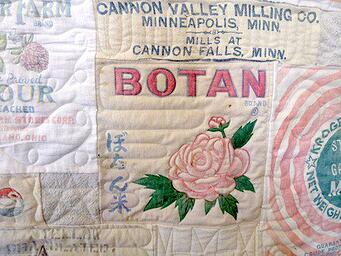 close up of a quilt made from feedsacks