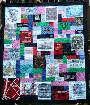 This is T-shirt quilt with blank block fillers to increase the size of the quilt.