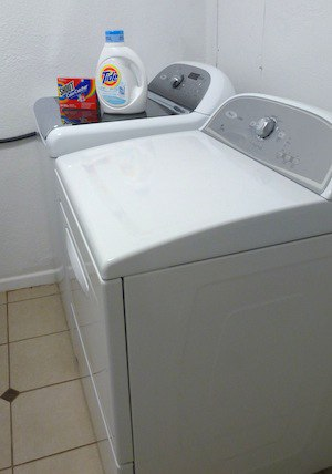 Photo of the washing machine and dryer that we use to wash the fabric we use on a T-shirt quilt.