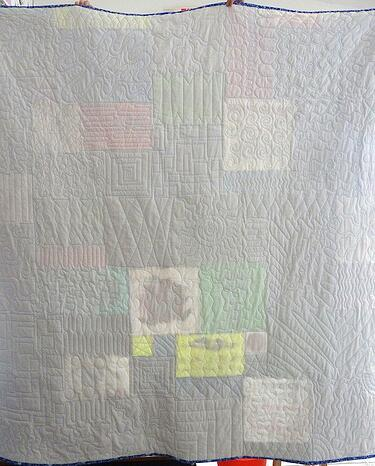 white on the back of a t-shirt quilt