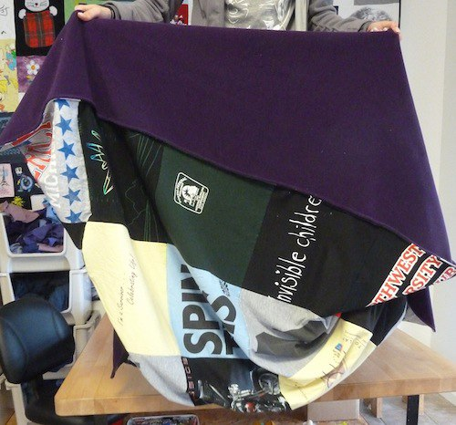 Click on me to see photos of real T-shirt quilts!
