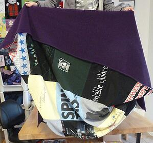 This is a photo of a T-shirt blanket where the backing is not connected to the quilt top.