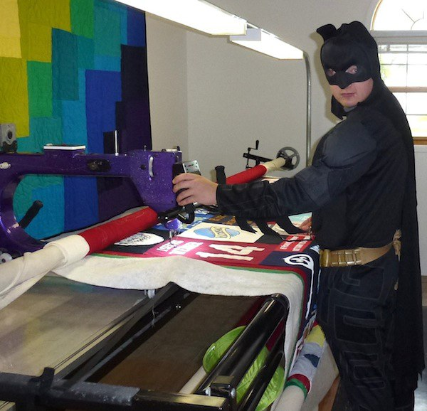 Batman quilting a T-shirt quilt