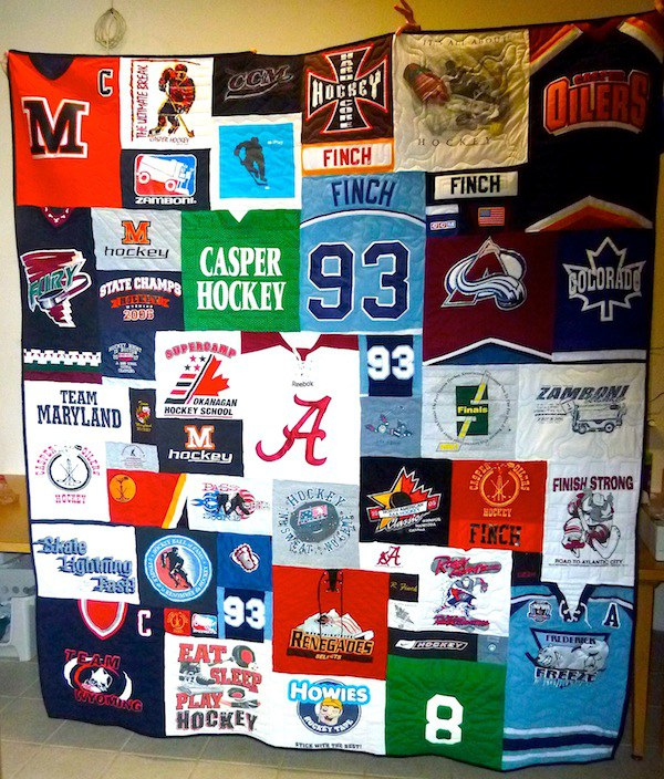 This photo is of a quilt made from hockey jerseys