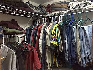 sorting the clothing of a deceased loved one