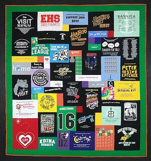 "A great graduation T-shirt quilt with a 4"" solid green border."