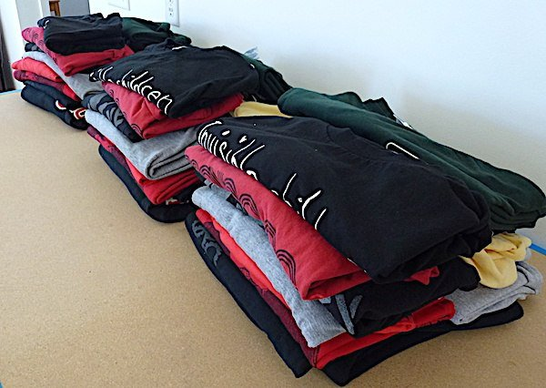 3 stack of identical T-shirts for comparison