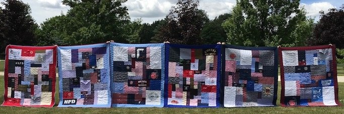 6 memorial quilts in a line