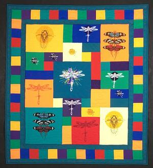 A T-shirt quilt made from T-shirts with bugs on them.