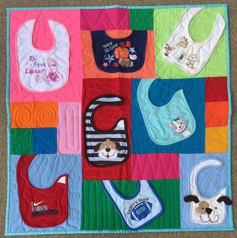 quilt made from baby bibs
